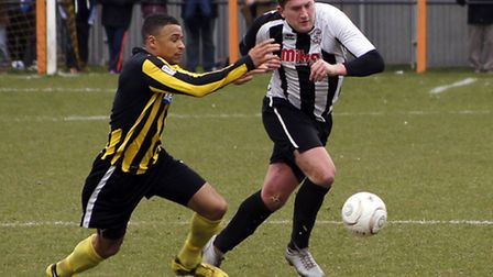 IN HIS DEFENCE: Will Fordham does his job at the back. Picture: Gemma Thompson.