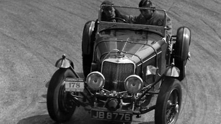 Squadron Leader Matthew Drummond Wilson driving his Squire racing car at a rally in Scotland