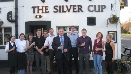 Tony (middle) and the team at the pub's St George's Day relaunch