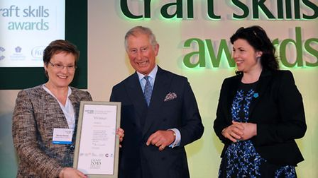 Wendy Shorter, left, presented with an award by the Prince of Wales and Kirstie Allsopp at the Craft