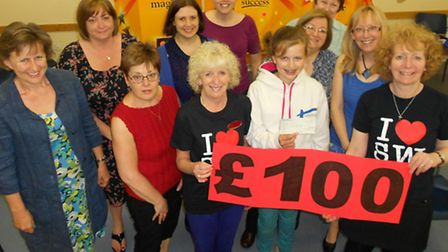 Maddie Huffer (front row, second from right) collects the cheque from Royston Slimming World group