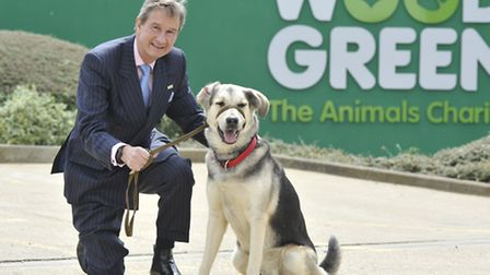 Retiring Dennis Baker, Chief Executive of Wood Green, with Dodger the dog