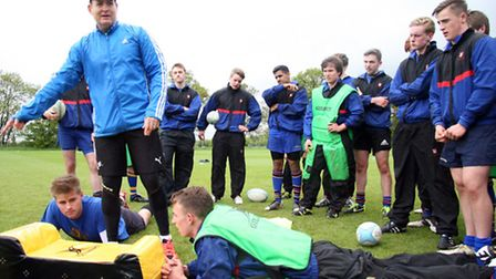 Rugby star David Campese takes a training session with St Albans school 1st XI