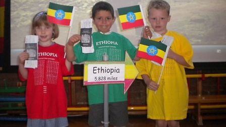 Tannery Drift students with their passports plotting a trip to Ethiopia