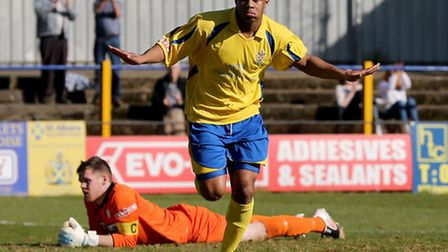 Greg Ngoyi peels away after scoring for City. Picture by Leigh Page