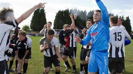 LET THE PARTY BEGIN: St Ives Town players celebrate their win and promotion. Picture: Louise Thompso