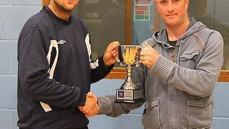 SG8 manager Kenny Blair receives the league winners' trophy from league co-ordinator Jorden Gibson