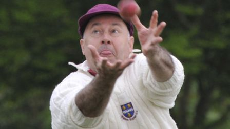 SLIPPING THROUGH THE FIGURES: Jerry Hide of Abbots Ripton drops a catchagainst Haddenham. Picture: H
