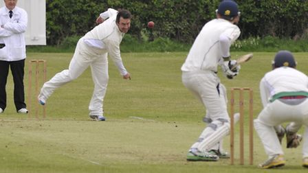 IN ACTION: Warboys bowler Matt Cooksey bowls in their match against Caldecote. Picture: Helen Drake.