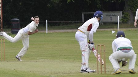 MORE ACTION: Jack Skidmore of Warboys bowls in the Premier Two side's match against Caldecote. Pictu