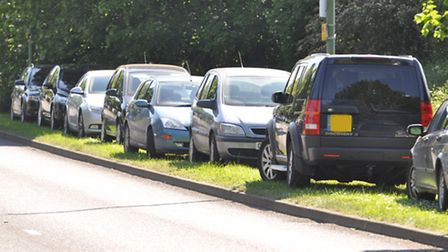 Cars parked on Bluehouse Hill