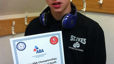 GREAT ACHIEVEMENT: Bradley Smith shows off his certificate for making the semi-finals of the Junior