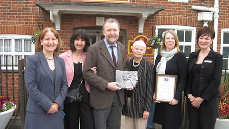 Neil Levoir (third left) and Jane Pearson (second right) receive their awards accompanied by headte