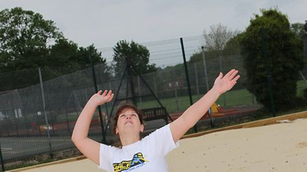 Community projects officer Jo Howlett lines up a serve on the beach volleyball court in verulamium p
