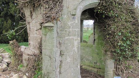 The ruined porch of the old Colne church