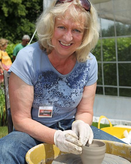 Jenny Jackson moulds some clay on a potters wheel
