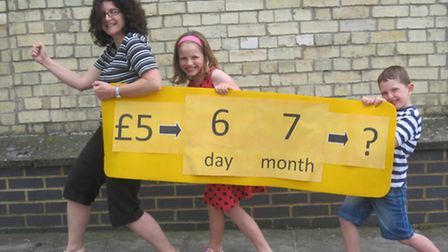 Clare Swarbrick and her children Katherine and Jonathan prepare for the latest Royston Cash Mob