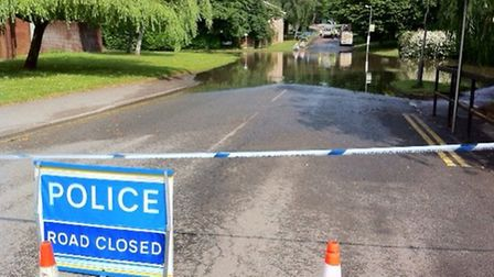 A burst water main in Mayne Avenue has caused flooding across the road