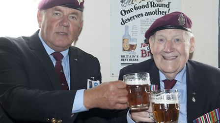 Left to right, Gil Boyd of the Airborne Assault Museum with Sergeant Edward Johnny Peters, enjoying