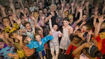 Cast members of the Ajs Dance Academy show All aboard on stage with Molly Moore whose charity all p