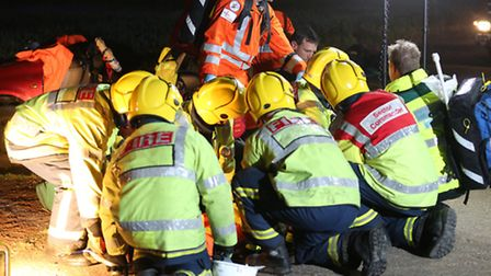 Emergency services attend to victims at staged accident