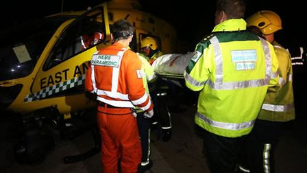Air ambulance staff take casualty aboard after staged accident