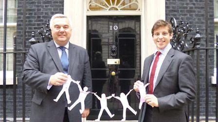 Oliver Heald, accompanied by former Buntingford schoolboy, Fergus Martin, with the artwork outside N