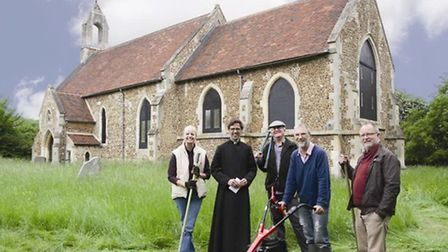 The Reverend Steven Rothwell with the mower, and volunteers Sarah Brennan, John O'Sullivan, Peter Ma