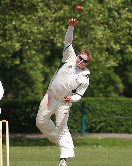 Tom Greaves bowling against St Albans