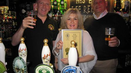 John Bishop (left) of South Herts CAMRA presenting the silver award certificate to Jo and Patrick Re