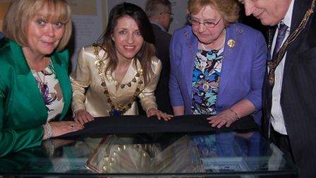 Looking at one of the exhibits at the Magna Carta 1213-1215: The Journey Starts Here exhibition are,