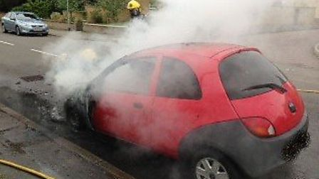 Firefighters tackle Ford Ka fire