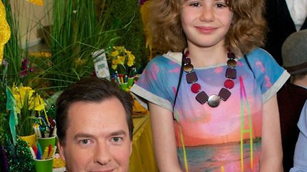 Molly standing behind George Osbourne