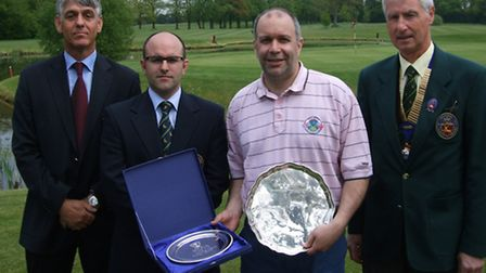 Jeremy Bohn is presented with his prize, the County Salver, by the Hertfordshire Golf Union at Aldwi