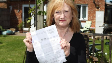 Councillor Dreda Gordon holds a the suspected fraudulent letter from a European lottery