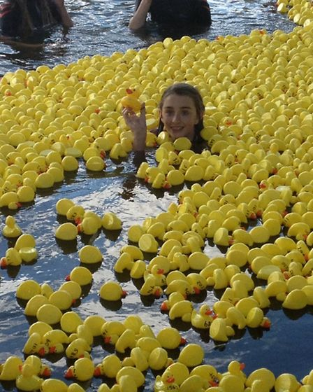 Hannah Melesi, 13, who swam with the ducks, pictured at the finish line