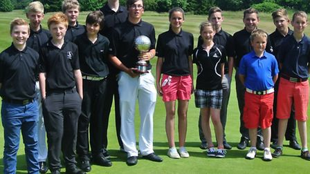 Conor O'Grady (centre) with the Eric Russell Trophy and members of the victorious Redbourn Juniors.