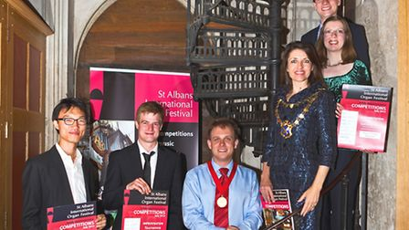 Mayor with prizewinners on cathedral staircase