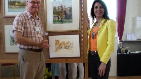 The Mayor and Chairman, Peter Osborne, with the winning picture of the St Albans Trophy by Bridget T
