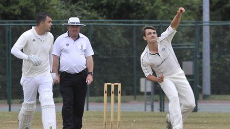 Ramsey II's bowler Ed Manchett in action against Huntingdon & District in Division One of the Hunts