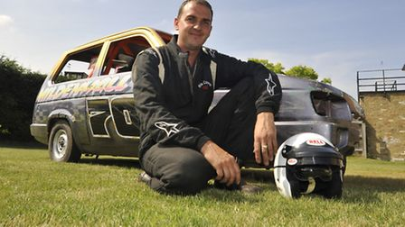 Robin Reliant Racer Allen Cooper in front of his latest mean machine. Picture: Helen Drake.