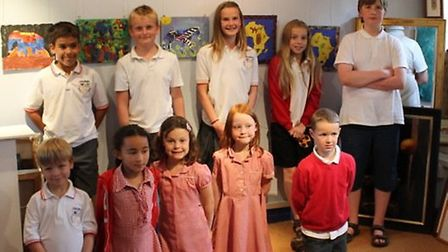 Pupils from GUilden Morden Primary School with their winnin gpieces of artwork