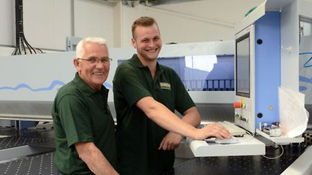 Broadcraft director Bill Chambers with a member of staff at the St Neots factory