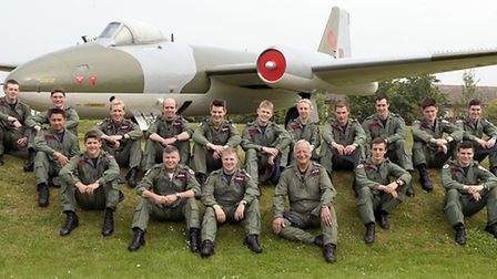 Members of 57 Sqn RAF Wyton group photograph by gate guardian after they had restored it.