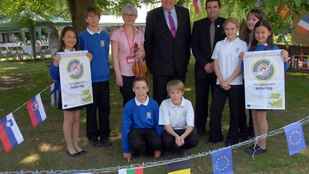 Violinist Marie-Luce Gillet, MEP Richard Howitt, principle Simon Holmes with Year 9 pupils