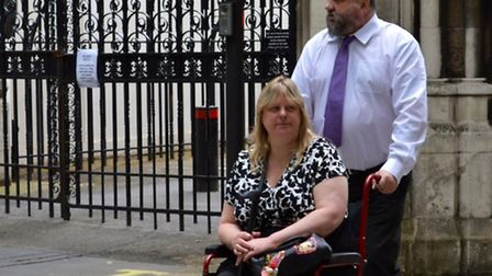 Nursery worker Aileen Cooper, pictured in the wheelchair, has made a claim for a £2 million damages