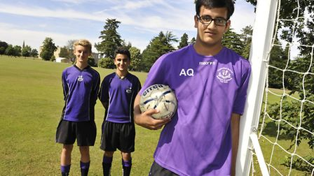 Young Football Manager Ammar Qadeer (15) at Kimbolton School, with his players (l-r) Oli HAle and Si