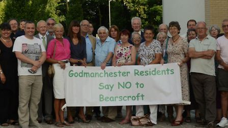 Campaigners opposed to the Bearscroft Farm development outside the district council offices before M