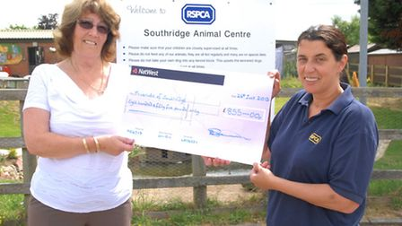 Patricia Bannon hands over a cheque to Centre manager Anna White
