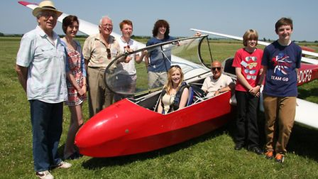 Student Katie Barkans tries out the glider with Peter Valentine (Vice-chairman of NVGC), left, Mich